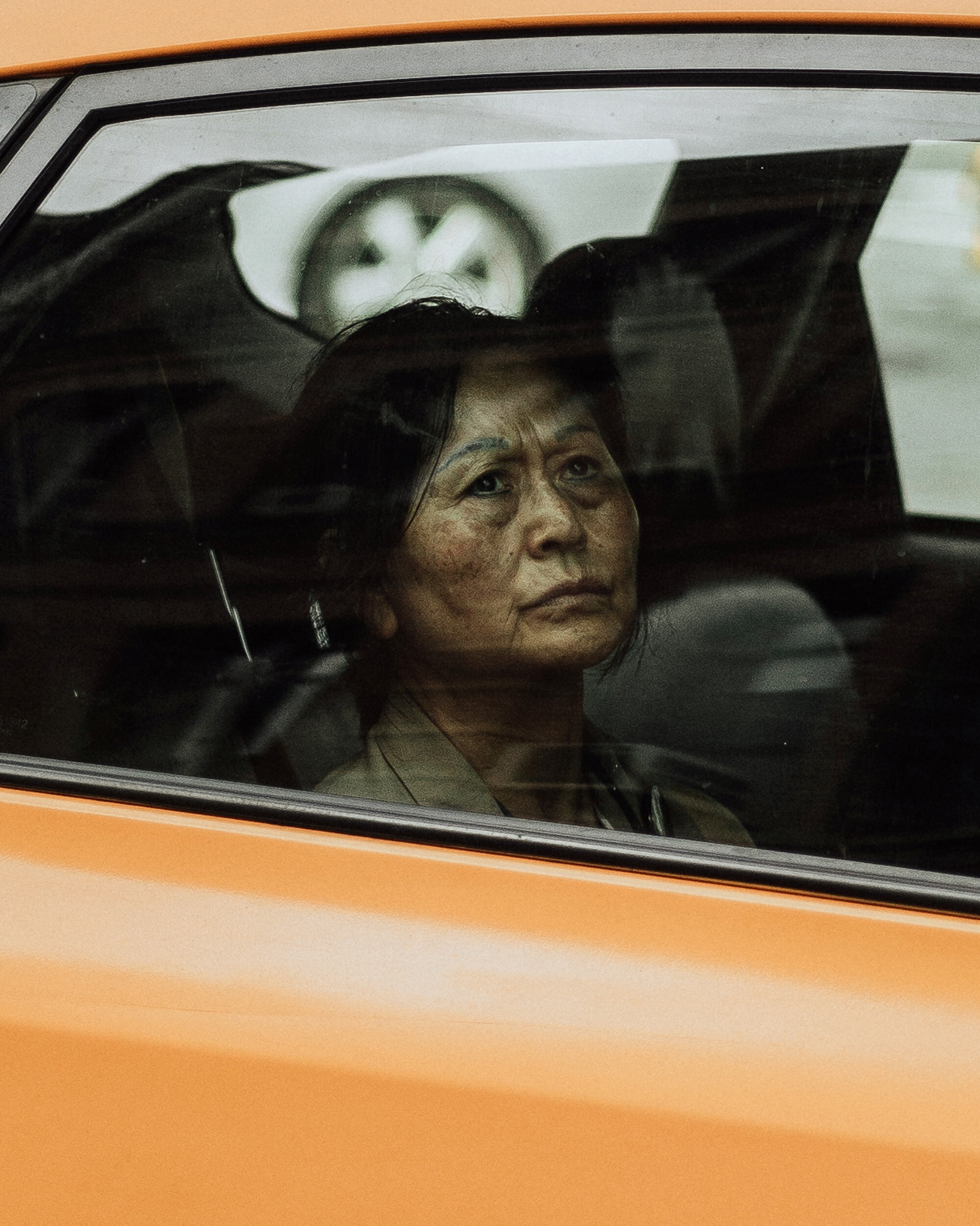 Woman driving in a yellow cab, reflection, street photography, new york city, michelle viljoen